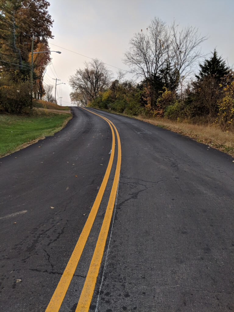 paved road with double yellow stripe down the middle