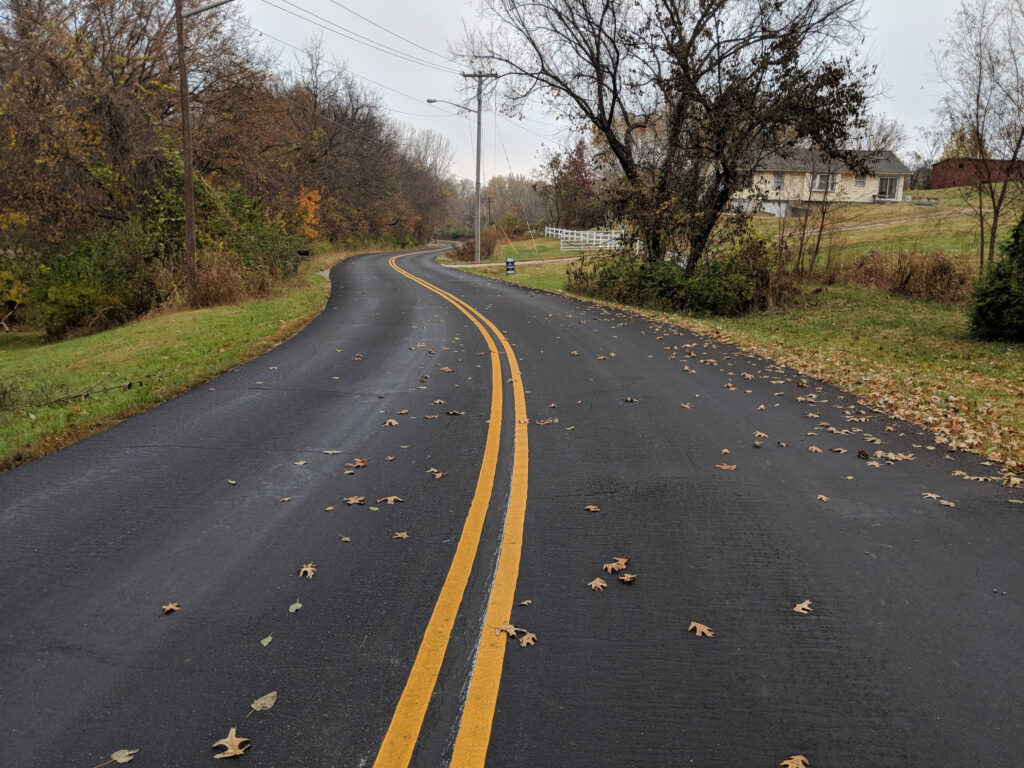 beautiful paved road with yellow double lines